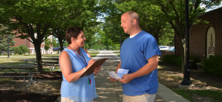 Photo of a researcher conducting a survey with a participant