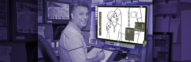 Designer using a digital tablet to draw image displayed on a computer monitor